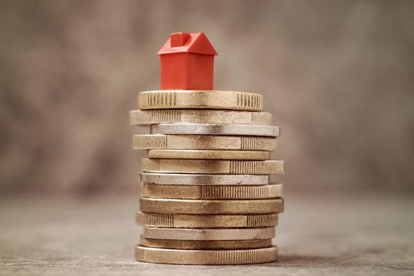 3.アパート経営の収支のしくみ コインと住宅模型
